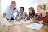 stock photo of teachers  - Business school students in marketing class with teacher - JPG