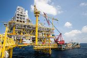 stock photo of barge  - Large crane vessel installing the platform in offshore - JPG
