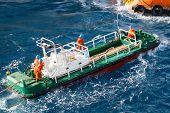image of work crew  - boatman working on deck supply boat - JPG