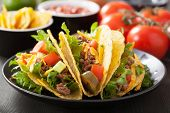taco shells with beef and vegetables