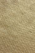 stock photo of tan lines  - a background of tweed tan or camel colored knit fabric is braided in lines - JPG