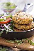 picture of veggie burger  - Vegan burgers with quinoa and vegetables served with arugula and salad - JPG