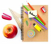 School Supplies With Globe, Apple, Pencils And Notebook  On White Background