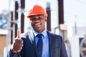 picture of substation  - happy african industrial manager with thumb up at substation - JPG
