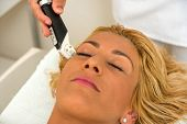 Therapist applying lipo massage LPG treatment - selective focus narrow DOF poster