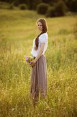 pic of beatitudes  - Lonely woman with bouquet of flowers standing in a field - JPG