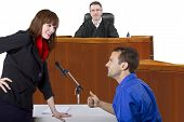 image of courtroom  - defendant with lawyer speaking to a judge in the courtroom - JPG