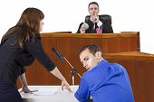 picture of courtroom  - corrupt judge taking bribe in an unfair courtroom trial - JPG