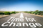 stock photo of horizon  - An image of a road to the horizon with text time for change - JPG