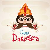 stock photo of ravana  - Funny face of Ravana with big black eyes  and brown moustaches wearing a golden and orange crown with crackers - JPG
