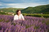 picture of ordinary woman  - Woman in the middle of lavender field - JPG
