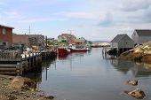 foto of shacks  - Coastal village of Peggys Cove Nova Scotia Canada showing seaside shacks fishing boats and houses along the coast - JPG