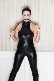 pic of sado-masochism  - Sexy woman with whip in black latex catsuit desire - JPG