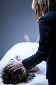 picture of life after death  - Young woman being in deep mourning after death of relative - JPG