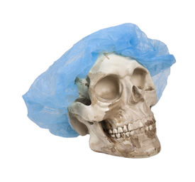 picture of eye-sockets  - Skull with eye sockets and teeth wearing a medical hair net - JPG