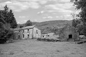 stock photo of farmhouse  - old abandoned farmhouse in the mountains of county Kerry Ireland in black and white - JPG