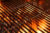 stock photo of fiery  - BBQ Grill with Glowing Coals and Bright Flames - JPG