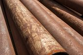 stock photo of orifice  - Rusty metal pipes stack on the construction site - JPG