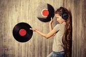picture of studio  - Cute happy teen girl enjoys the music in headphones - JPG