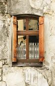 image of lace-curtain  - Wooden window with shutters and lace curtains - JPG