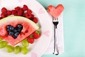 pic of watermelon slices  - Fresh juicy watermelon slice  with cut out heart shape - JPG
