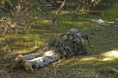foto of sniper  - Sniper with ghillie waiting for target in an Airsoft party - JPG