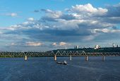 picture of sloop  - The barge floating in the blue Dnieper waters against the summer Kyiv landscape - JPG