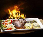 picture of porterhouse steak  - t bone steak with potato salad and vegetables - JPG