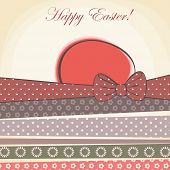 picture of baby easter  - happy easter card. easter egg with pattern ribbons 