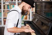 image of beard  - Handsome young bearded men playing piano and singing - JPG