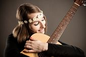 pic of ordinary woman  - Young woman with acoustic guitar and flower hairband - JPG