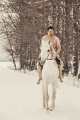pic of beast-man  - Wild man on horseback at winter day - JPG