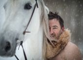 picture of beast-man  - Portrait of a wild man at winter day