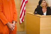 stock photo of court room  - Judge looking the condemned prisoner in the court room - JPG