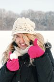 Постер, плакат: Happy Woman In Snow Holding Snow Ball In Hand For Snowballing