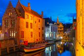 stock photo of medieval  - Scenic cityscape with the picturesque night medieval canal Dijver in Bruges - JPG