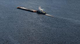 stock photo of sloop  - The barge floating in the blue Dnieper waters - JPG