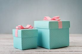 picture of ribbon decoration  - Blue polka dots gift boxes with pink ribbons on wooden background - JPG