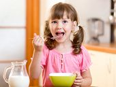 pic of healthy eating girl  - child girl eating healthy food in kitchen - JPG