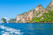 stock photo of phi phi  - Cliff and the clear sea with a boat near Phi Phi island in south of Thailand - JPG