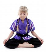 pic of karate-do  - Little girl in kimono doing exercises isolated on white - JPG