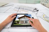 picture of blueprints  - Businessperson Hands With Digital Tablet Over Blueprint In Office - JPG