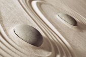 pic of purity  - zen meditation stones lines in sand for balance harmony and relaxation spa massage stone - JPG