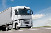 stock photo of truck-cabin  - White cabin and part of lorry truck body moving on road - JPG