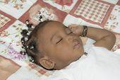picture of cornrow  - Adorable baby girl sleeping in her room  - JPG