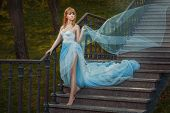 stock photo of fable  - Young girl like a princess runs on the stairs - JPG