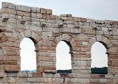 stock photo of arena  - detail of Roman arches outside of the Arena di Verona in Italy - JPG