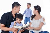 stock photo of toothless smile  - Happy family portrait smiling together  - JPG