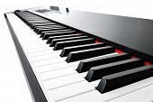 foto of keyboard  - Synthesizer keyboard music instrument studio shot at interesting perspective on white background - JPG