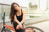 picture of swag  - Colorful outdoor portrait of young pretty fashion model with bike - JPG